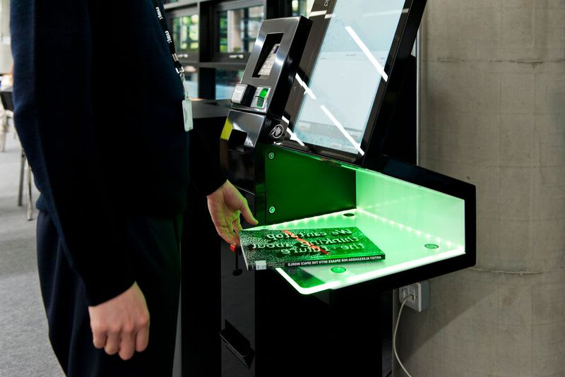 Student scanning a book on a borrowing machine