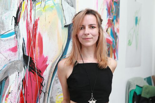 Photo of Daniela Raytchev in front of one of her works